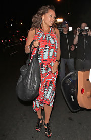 Vanessa Williams black leather gladiator heels complemented her abstract print maxi dress.