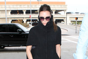 Singer Victoria Beckham seen catching a flight at LAX airport in Los Angeles, CA. Victoria was showing off her fashion even though she was just getting on a plane.