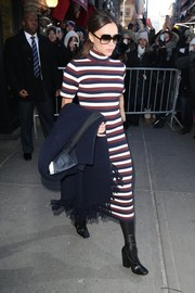 Victoria Beckham grabbed dinner in Soho wearing a tricolor striped turtleneck from her label.