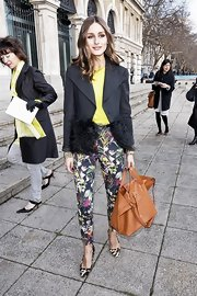 Olivia Palermo accented a vivid top and bold floral print pants with a supple tan leather tote.