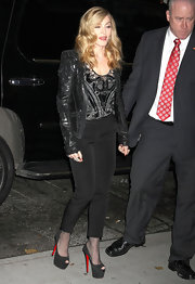 Madonna topped off her ensemble with black suede platform peep-toe pumps.