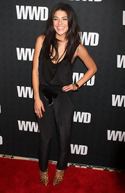 Jessica Szohr kept her black jumpsuit on trend by pairing it with pointy leopard ankle boots by Christian Louboutin.