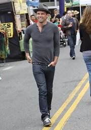 Walton Goggins chose this gray henley for his casual look while heading to the farmer's market with his family.