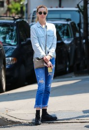 Whitney Port kept it cool while out and about in a light-wash denim shirt to complete her matchy look.