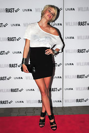 Lena dons a high waisted mini skirt for the William Rast fashion show.