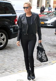 Yolanda Hadid finished off her edgy ensemble with pointy black ankle boots.