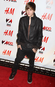 Justin rocks maroon leather sneakers with his dark style at Jingle Ball in Madison Square.