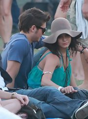 "Vanessa wore the brown ""Janis Brim Hat"" with a loose-fitting tank top and hippie-chic accessories."