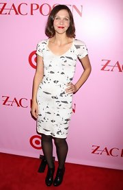 Maggie attended the Zac Posen event but opted not to wear one of the designer's pieces. She wore a fitted white and gray-printed dress with short sleeves and a v-neck.