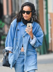 Zoe Kravitz hid her eyes behind classic wayfarer sunglasses while strolling in New York City.