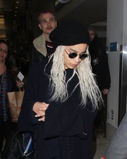 Zoe Kravitz kept a low profile with a black wool beret and a pair of round shades while catching a flight out of LAX.