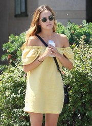 Zoey Deutch topped off her look with a pair of clear-rimmed shades.