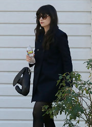 Zooey Deschanel accessorized her classic coat with a quirky bunny-shaped leather purse.