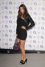 Lauren Budd paired her little black dress and leather jacket with a purple shoulder bag.
