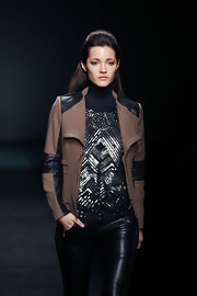 Malena Costa modeled a metallic turtleneck top by Javier Simorra at Barcelona Fashion Week 2013.