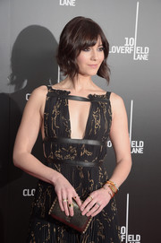 Mary Elizabeth Winstead arrived for the New York premiere of '10 Cloverfield Lane' carrying a stylish gold clutch by Yliana Yepez.