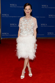 Cynthia Rowley completed her whimsical outfit with a white feather skirt.
