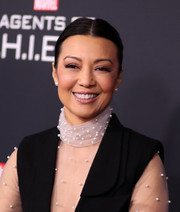 Ming-Na Wen opted for a simple center-parted ponytail when she attended the 'Agents of S.H.I.E.L.D.' 100th episode celebration.