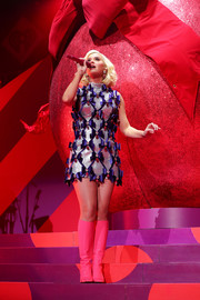 Katy Perry looked like a perfectly wrapped gift in a beaded and bowed mini dress by Zaldy while performing at 101.3 KDWB's Jingle Ball 2019.
