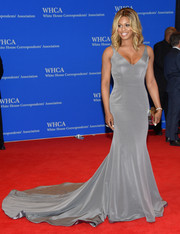 Laverne Cox worked the red carpet in a floor-sweeping gray gown by Ines Di Santo during the White House Correspondents' Association Dinner.