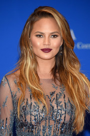 Chrissy Teigen finished off her look with a bold berry lip.