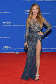 Chrissy Teigen added extra sparkle with a pair of bedazzled sandals by Giuseppe Zanotti.