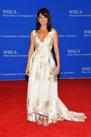 Carla Gugino paired her dress with bedazzled silver strappy sandals by Pedro Garcia.