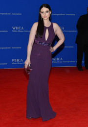 Michelle Trachtenberg complemented her dress with a box clutch in various shades of purple.