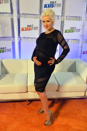 Christina Aguilera didn't let her baby bump get in the way of her sexy style, wearing this multi-patterned, sheer black Roberto Cavalli dress to the Wango Tango event.