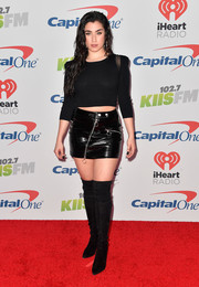 Lauren Jauregui chose a black leather mini skirt to pair with her top.