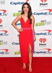 Sarah Hyland was matchy-matchy in this red high-slit maxi skirt and crop-top combo by Rasario.