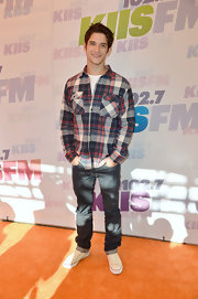 Tyler Posey chose a red, white, and blue plaid button down for his casual look at Wango Tango.