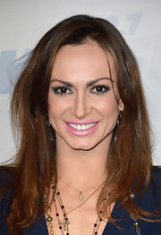 Karina Smirnoff chose a pastel pink lipstick to give her a feminine and flirty beauty look.