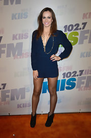 Karina showed off her toned dancer's legs with this long-sleeve navy romper.