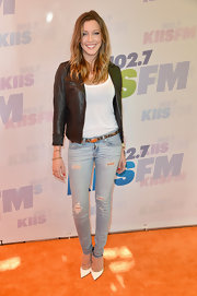 Katie Cassidy rocked a pair of light-wash ripped denim jeans while at the Wango Tango red carpet.