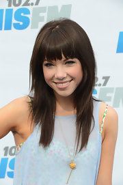 Carly Rae Jepsen went to a KIIS FM radio event wearing her choppy layers with lash-length bangs.