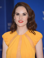 Michelle Dockery's red lipstick and marigold outfit made a gorgeous color combo!