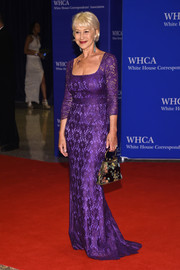 Helen Mirren paid tribute to Prince by wearing a purple lace gown and a tattoo of his love symbol during the White House Correspondents' Association Dinner.