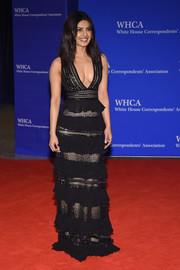 Priyanka Chopra put on an alluring display in a black Zuhair Murad gown with a plunging neckline and a layered skirt during the White House Correspondents' Association Dinner.