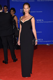 Christy Turlington-Burns looked ageless in a form-fitting, cleavage-baring black gown at the White House Correspondents' Association Dinner.
