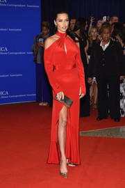Adriana Lima's bejeweled satin pumps provided a classic and conservative contrast to her modern dress.