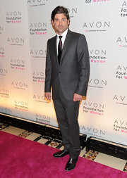 Patrick Demsey showed off a sleek grey suit while hitting the 10th Annual Avon Foundation For Women Gala.