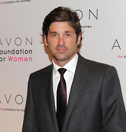 Patrick Dempsey showed paired his sleek grey suit with a deep purple tie.