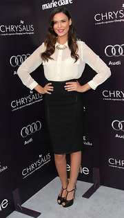 Odette looks phenom in a sophisticated black pencil skirt for the Butterfly Ball.