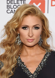 Paris Hilton wore a pair of Jacob & Co. chandelier earrings to match the sparkle of her dress.