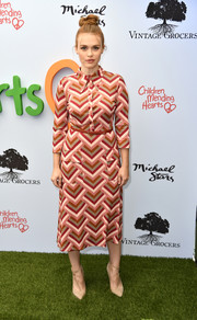 Nude T-strap pumps finished off Holland Roden's outfit.
