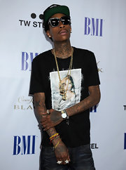 Wiz Khalifa wore a graphic t-shirt with jeans and gold chains for the BMI Urban Awards.