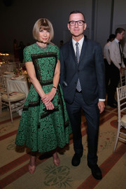 Anna Wintour donned a green and black lace cocktail dress in her signature short-sleeve, fit-and-flare style for the CFDA/Vogue Fashion Fund Awards.