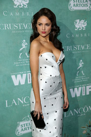 Eiza Gonzalez paired a black box clutch with a strapless polka-dot dress for the Women in Film pre-Oscar party.
