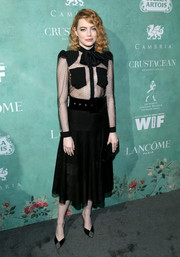 Emma Stone turned heads in a sheer-bodice shirtdress by Givenchy at the Women in Film pre-Oscar party.